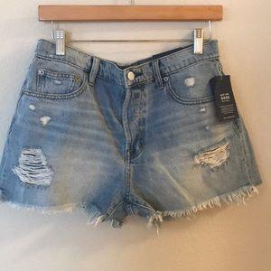 High rise destroyed denim shorts